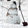 Snowman: A snowman stands along Davis Avenue near Rea Park Tuesday morning.