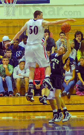 Tall order: Evansville Reitz guard Clinton Happe(3) finds Justin Gant(50) in his way as he tries to score in first half action in the Patriots gym Tuesday night.