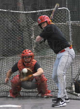 Patience: Tim Tepe waits on a pitch while taking swings in the batting cage during Tusday's practice.