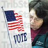 Illinois voter: Robinson, Illinois resident Carolyn Bachelor votes at her precinct Tuesday afternoon.
