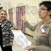 New proceedure: Crawford Co. Illinois Clerk Patricia Lycan (L) talks with election judge Mickie Owens about the new proceedure for checking ballots when voters don't vote all the races on the ticket Tuesday evening at the police station polling place.