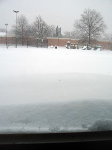 Playground at the Lee Center during the peak of the blizzard conditions -- note that the snow against the window comes up to the middle of the photo (1:53pm on Wednesday, Feb. 10)
