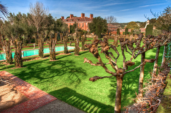 View of the Filoli pool. mansion, and lawn from the Tennis Court. It appeared as if the tennis court was used for weddings now a days.