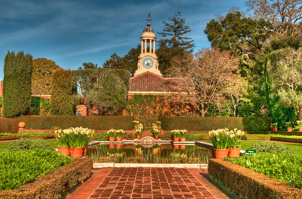 The reflecting pool, clock-tower and surrounding flowers at the Filoli Gardens.
