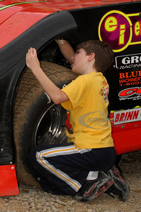 Eddie Carrier, Jr's little brother Geoffrey works on scraping some mud off the car