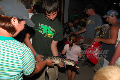 Chris Wall's son Ranger with one of their many alligators