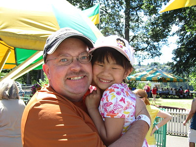 5 years ago in China she wasn't quite so happy to be photographed with Dad
