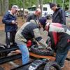 Bill mounts a new tire for Steve