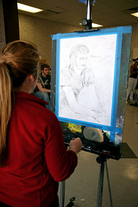 Art students hard at work during class.