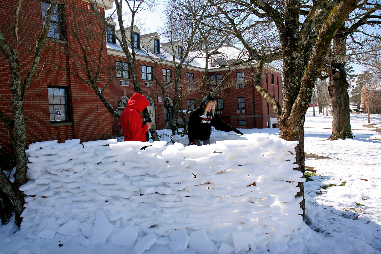 Students build a fort of ice outside of Decker Residence Hall.