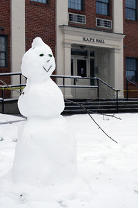 A snowman keeps an eye on the Quad outside HAPY Hall Saturday afternoon.