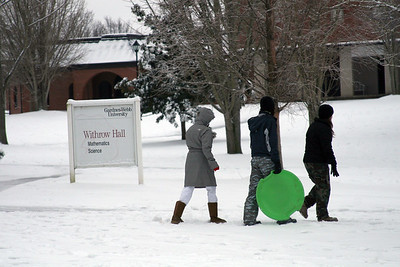 Several students brave the below-freezing temperatures Saturday afternoon to go sledding.