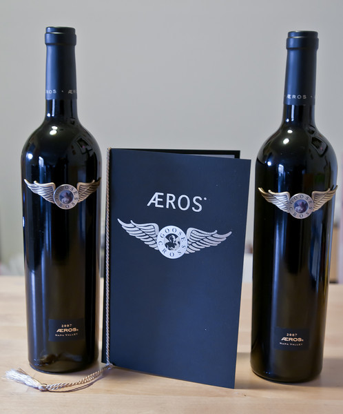 """My first 2 bottles of Goosecross' Aero's Meritage. These are my 2 most expensive bottles (at $130 each). This is the 3rd time in Goosecross' 25 year history that they released an Aeros.  The 2007 Aeros is 70% Estate Cabernet Sauvignon, 15% Estate Petite Verdot, 10% Estate Merlot and 5% Estate Cabernet Franc. Only 228 cases were made.  This wine is named Aeros for the Greek winged god of love, and weaves together mystical themes of flight and loves. AEROS fell in love with the beautiful Psyche, a mortal woman who achieved goddess status through her marriage to AEROS. Psyche had the mystical power to turn water to wine and symbolized both sensual desire and intellectual pursuit. She is pictured in the center of the label. The myth relates how the desire, passion, seduction and eventual marriage of AEROS and Psyche brought love to earth.  Aeros represents the perfect balance between masculine and feminine energies on earth as it commemorates love, pleasure, lasting relationships, and all things with which wine has been associate since becoming the """"nectar of the gods.""""   Ae is a grapheme (or ligature) consisting of the letters A and E that occurs in many languages and is a member of the Old English alphabet. It seemed appropriate to use this ligature for AEROS since the producing winery name """"Goosecross"""" came from the Gorsuch family name, and in Old English """"Gorsuch"""" means """"where the goose crossed the stream."""""""