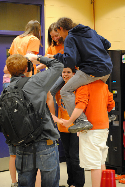 Teams work on Instant Challenge skills while a newspaper photographer captures the moment.