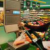 Here we have the veggie labeler - you pick your veggi out, get it's corresponding number from the sign, then take it over to this machine, plop it on the scale, plug in the number and zzt zzt, out comes the price label.  No more waiting behind vegans while the poor overwhelmed cashier flips through her dense volume of stuffs!