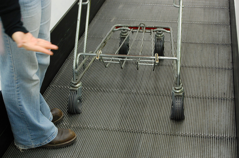 """flat tires fall in the grooves so you don't roll down the conveyor once you've """"boarded"""".  Genius!"""