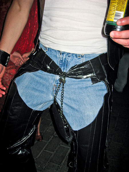 Mr. Slave's pants got a little feminine with the addition of a purse -- looks like he definitely got slaved.