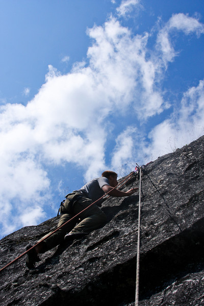 Mads heads up <i>Freedom Roof 5.10</i> high over Archangel Valley.