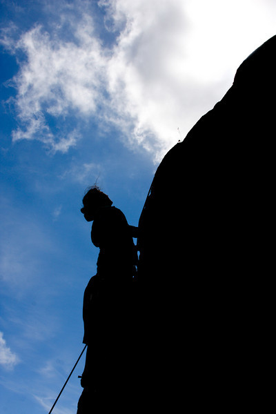 Tracy Borland climbs an unknown 5.9 on Zulu Wall in Archangel Valley.