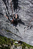Rachel works her way up the slab of <i>Voodo Child 5.10</i>.
