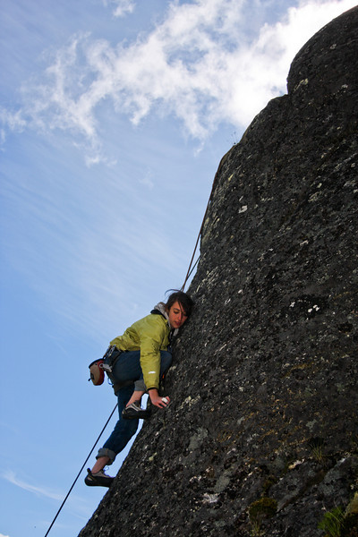 Rachel climbs an unknown 5.9 on Zulu Wall in Archangel Valley.
