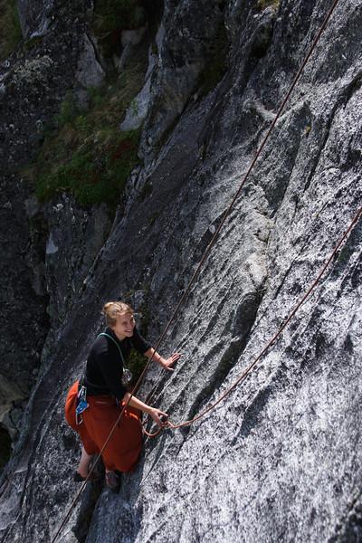 Tracy Borland works her way up the slab of <i>Voodo Child 5.10</i>.
