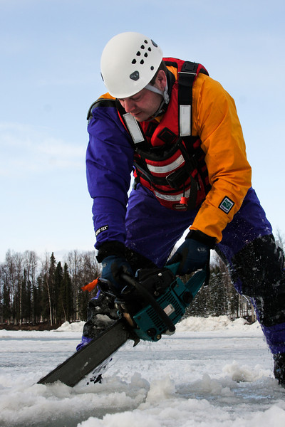 A four-foot bar is required on the chain saw to reach through the ice and gain access to the water below.