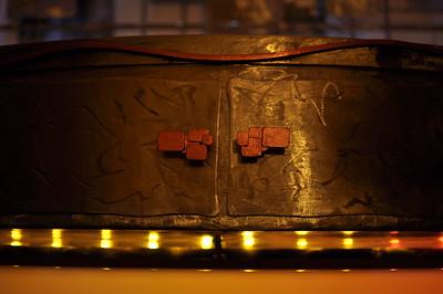 Detail of doors, handles, finish, and below tabletop lighting.