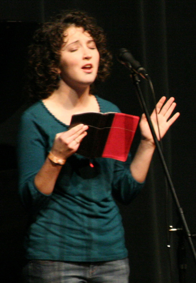 Elizabeth Cashwell begins the second service of Celebration Week Wednesday night by reading from scripture.