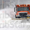Snow blade: Vigo Co. Highway Department driver Rusty Maurer uses his blade to clear a path along Mill Dam Road Thursday afternoon.