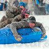 Tribune-Star/Joseph C. Garza<br /> Three man sled team: Stacked three high, The Bradburys, from top, Byron, Alexandra and Bill, speed down a hill on a tube at Deming Park Thursday.