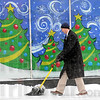 Snowman: Brian M. Ross shovels the sidewalk outside his 643 Ohio Street office Thursday afternoon.