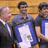 """Tribune-Star file photo/Joseph C. Garza<br /> Indiana Has Talent: Gov. Mitch Daniels poses for a photo with Terre Haute South students Raj Bhuptani and Sachin Shinde Monday, May 18, 2009 at the school. Bhuptani and Shinde were named """"Indiana Mr. Science"""" and """"Indiana Mr. Math,"""" respectively."""