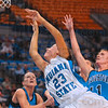 Tribune-Star/Joseph C. Garza<br /> Trying to get something started: Indiana State's Taylor Whitley draws the foul as she drives to the basket against the Creighton defense Thursday at Hulman Center.