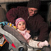 Tribune-Star/Joseph C. Garza<br /> One secure little pumpkin: Heather Roberts secures her eight-month-old daughter, Victoria, into her car seat after they participated in the first Howl for Child Safety event Thursday on Wabash Avenue.