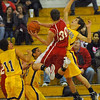 Challenge: Woodrow Wilson's Jacob Johnson(30) is fouled by Otter Drane Lansfield.