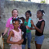 With friends: Jamalyn Peigh-Williamson with children in Haiti.