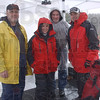 Chillin' for a cause: Gary Morris, Marla Flowers, Dave Adams and Troy Fears are spending time on the roof of Baesler's Market raising donations for the United Way. They are due to finish their ordeal at 6:00p.m. taday.