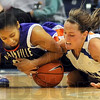 Hard fought on the hardwood: Evansville's Kaylan Martin and Lady Sycamore Krista Smith fight for control of the ball on the Purple Aces end of the floor.