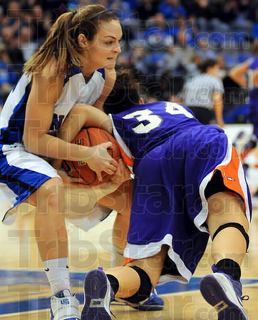 Tenacious: Lady Sycamore Krista Smith ties up Evansville's Stephanie Bamberger(34) in an attempt to steal an inbounds pass.