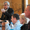 Tribune-Star/Joseph C. Garza<br /> Charter school discussion: Gibault, Inc. Chief Executive Officer James Sinclair, left, answers a question from an audience member during a forum Thursday on the school's charter school proposal.
