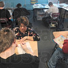 Tribune-Star/Joseph C. Garza<br /> One on one attention: Teacher Karen Olsen helps a student with a math problem during her class Thursday in Holy Cross School on the Gibault, Inc. campus.