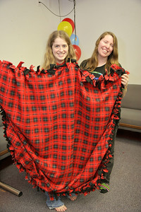MLK Day of Service at GWU: Volunteers make fleece blankets to hand out to select children at local elementary schools.