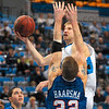 Tribune-Star/Joseph C. Garza<br /> Two of his 13: Indiana State's Aaron Carter drives to the basket over Evansville's James Haarsma during the Sycamores' 69-55 win Sunday at Hulman Center. Carter scored 13 points for the Sycamores.