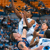 Tribune-Star/Joseph C. Garza<br /> Multi-tasking: EvansvilleÕs James Haarsma tries to block Indiana State's Harry Marshall, top, as he keeps a grip on Isiah Martin's jersey during the Sycamores' 69-55 win Sunday at Hulman Center.