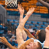 Tribune-Star/Joseph C. Garza<br /> In the thick of it: Evansville James Haarsma takes an arm from Indiana State's Isiah Martin during the Sycamores' 69-55 win Sunday at Hulman Center.