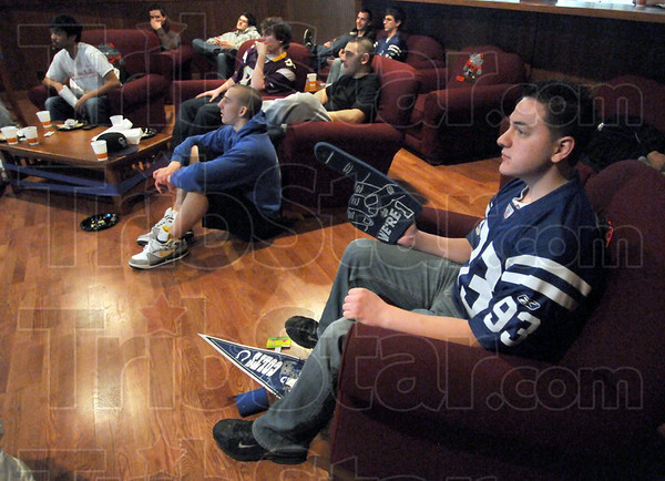 Big fan: Rose-Hulman student Matt McGhehey (R) watches the early action of the Colts/Jets playoff game Sunday afternoon on campus.