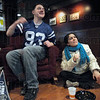 Go Colts: Rose-Hulman students Matt McGhehey and Homa Hariri watch first half action of the Colts/Jets game in the Student Union lounge Sunday afternoon.