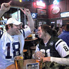 We're number one: Colts fan Cale Stonebraker (L) celebrates in the face of his friend Sarah Cox after a second half Colts score. Sarah is wearing a Jets jersey and is taking the celebrarion in stride. The two are watching the game from the bar area of BW3's.