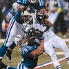 Tribune-Star/Joseph C. Garza<br /> Top and bottom defense: Indianapolis' Cody Glenn, top, and Chad Simpson, bottom, tackle New York kick returner Brad Smith during the AFC Championship game Sunday in Indianapolis.